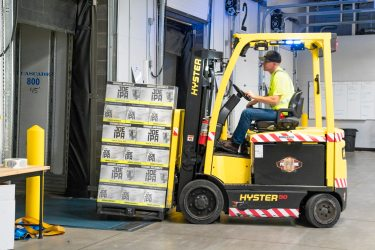 Elevate_main-riding-a-yellow-forklift-with