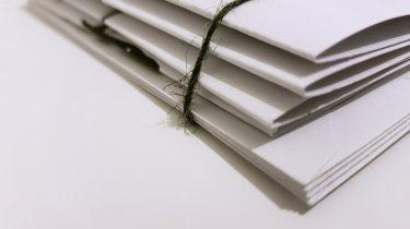 sam_johnson_white_paper_folders_with_the_black_tie